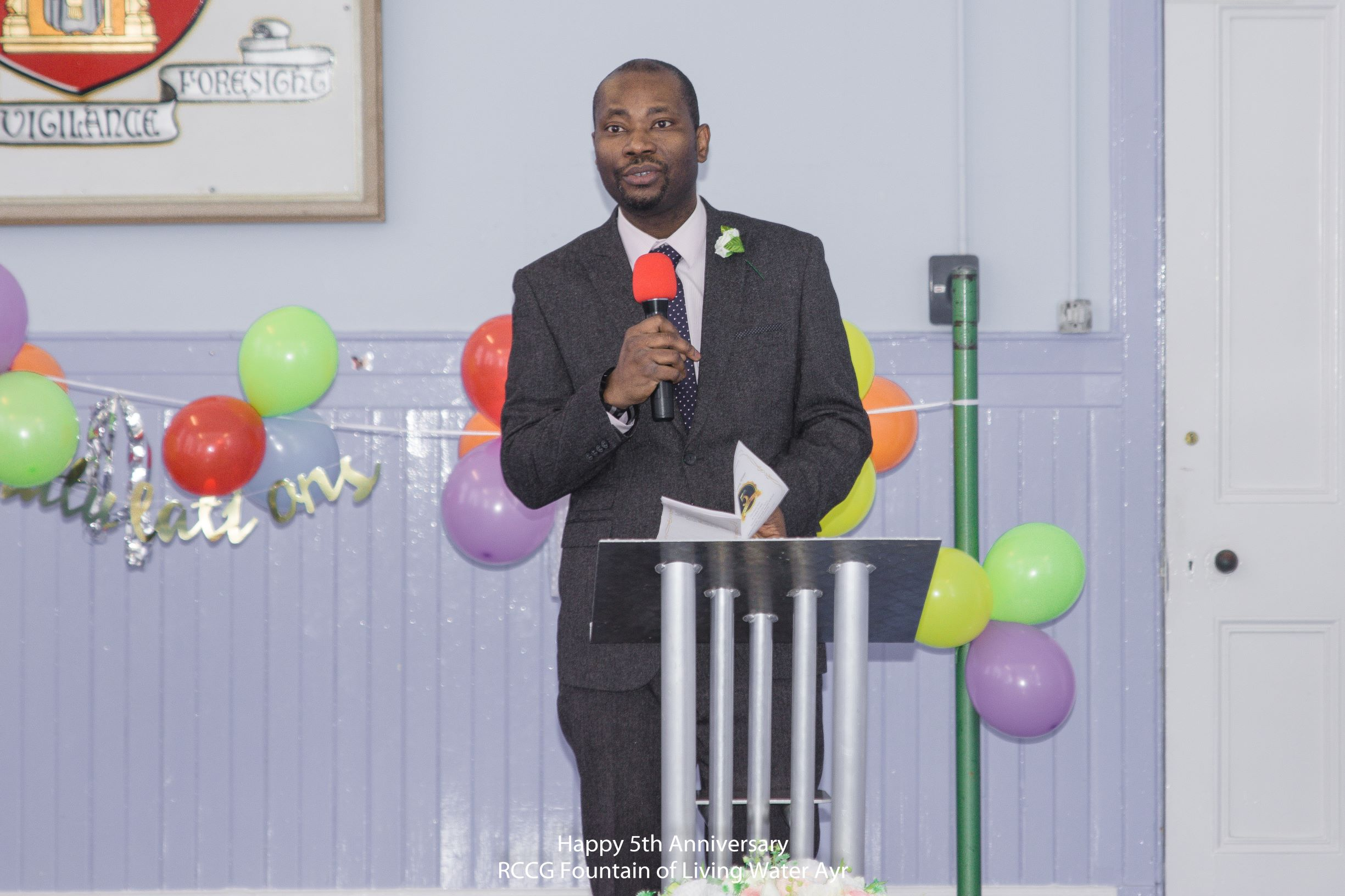 Pastor Yinka addressing the people at the service