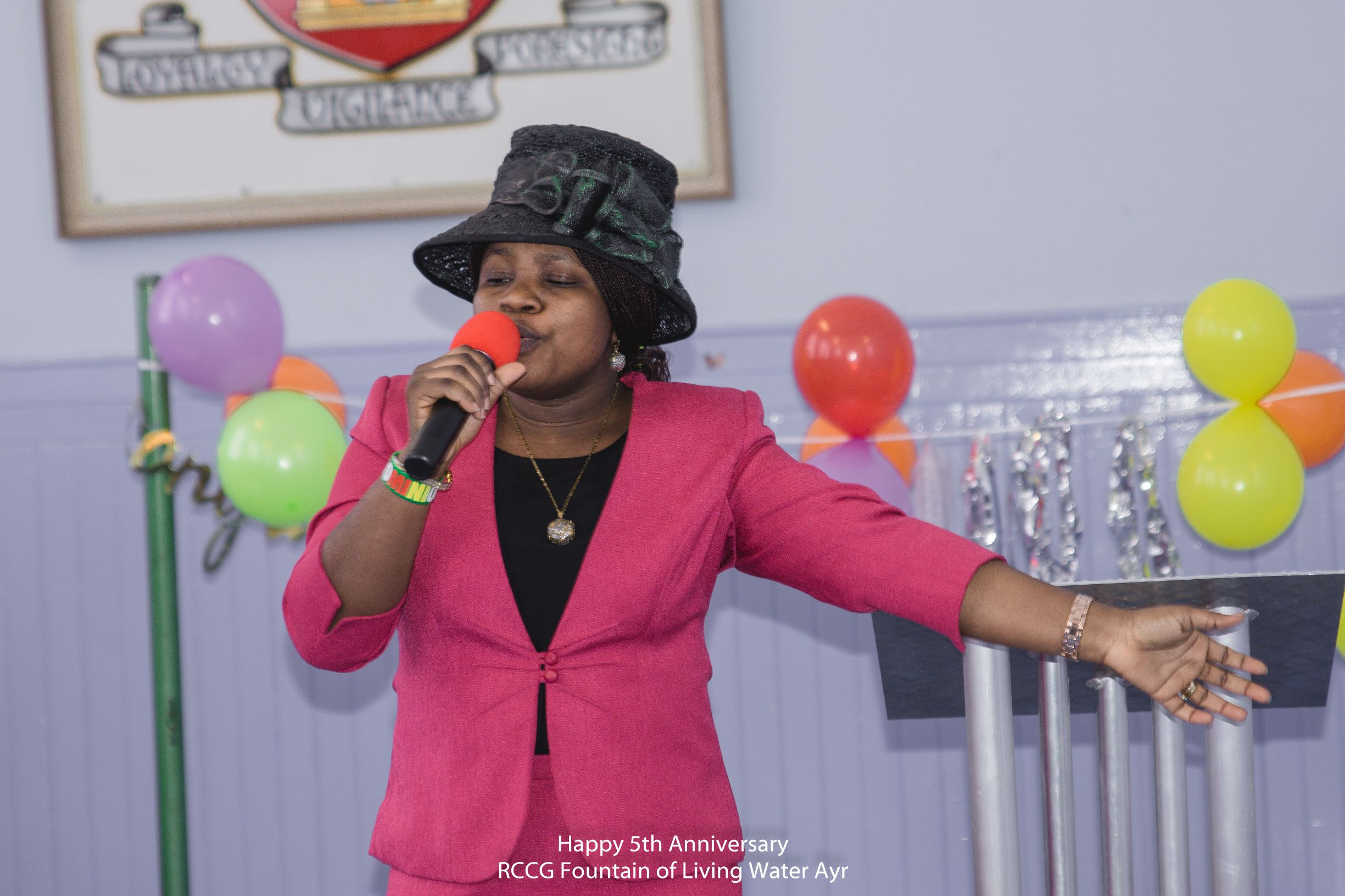 Pastor (Mrs) Adesina ministering at the service